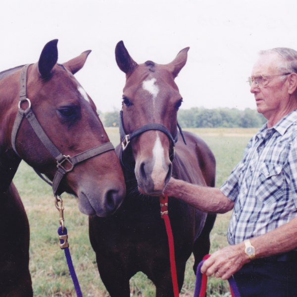 Lowell with horses_1481259638844.jpg
